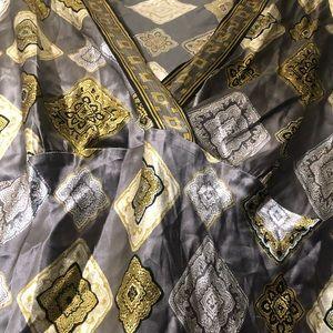 Versace inspired short sleeves gently used